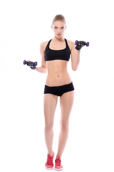 Beautiful woman doing exercises with dumbells