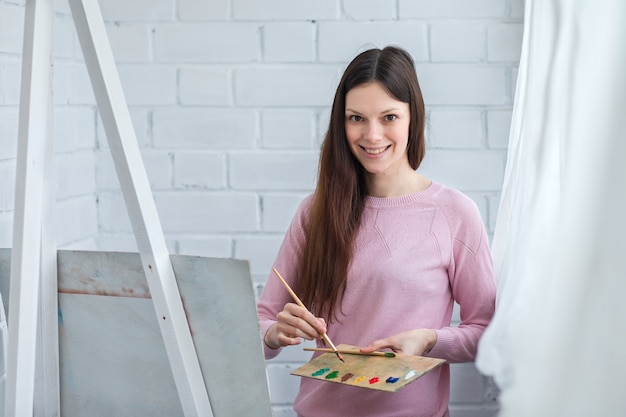 Beautiful woman draws