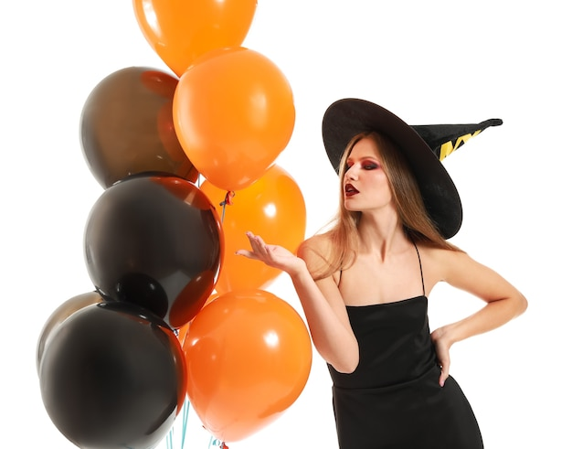 Beautiful woman dressed as witch for halloween isolated