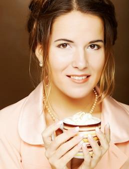 Beautiful woman drinking coffee. studio shot.