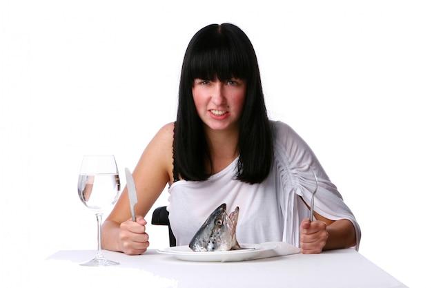 Beautiful woman eating fresh fish
