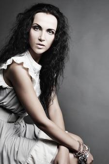 Beautiful  woman in elegant dress, studio shot