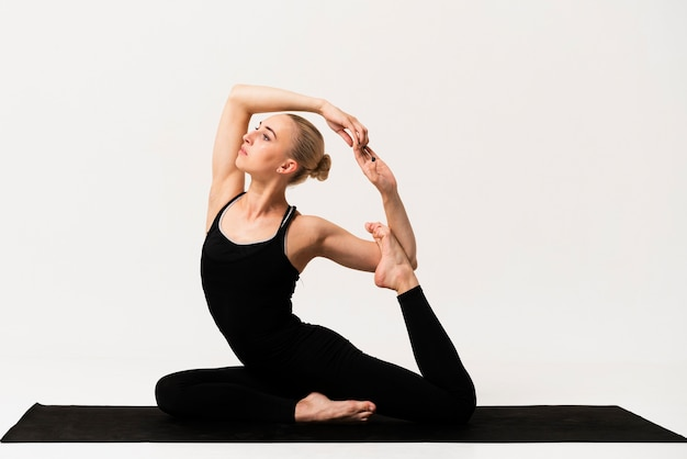 Beautiful woman elegant position at yoga class