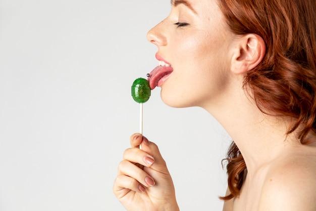 Beautiful woman enjoying a lollipop