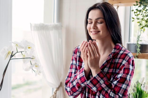 Beautiful woman enjoying mourning routine