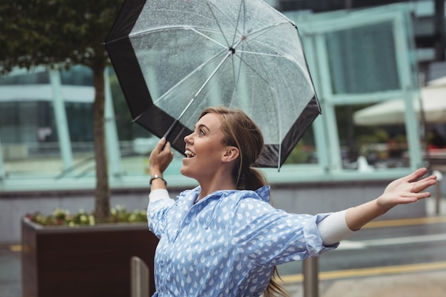 Beautiful woman enjoying rain