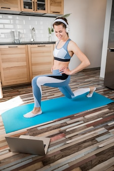 Beautiful woman exercising with music on