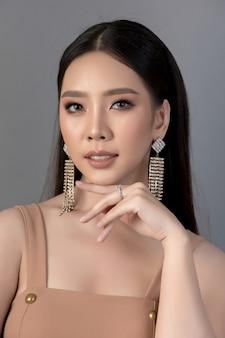 Beautiful woman face. hand of make-up