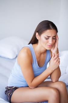 Beautiful woman feeling sick, having headache, painful body pain