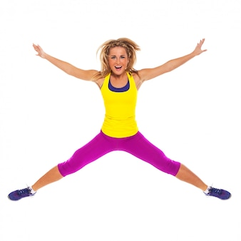 Beautiful woman in fitness wear jumping