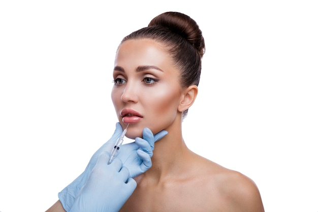Beautiful woman gets injections cosmetology beauty face