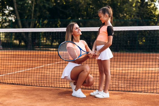 Beautiful woman giving directions on playing tennis