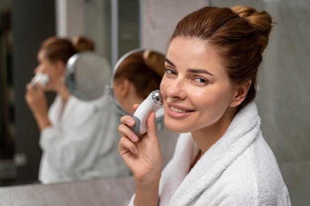 Beautiful woman giving herself a face massage