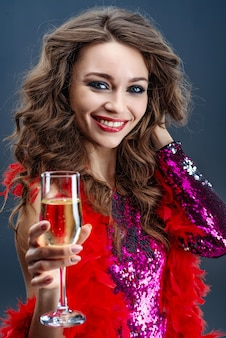 Beautiful woman gladly smiling raising glass of champagne