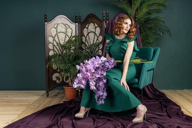 Beautiful woman in a green dress