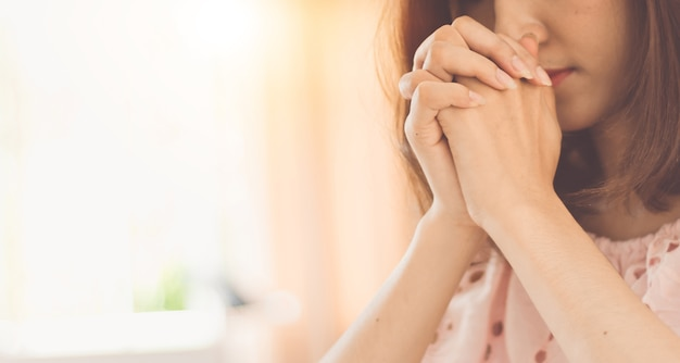 Beautiful woman hands praying to god.