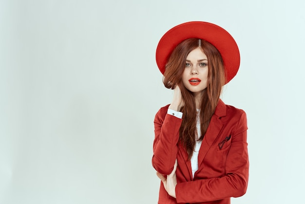 Beautiful woman in hat red lips jacket charm lifestyle studio light background. high quality photo