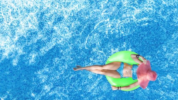 Beautiful woman in hat in swimming pool