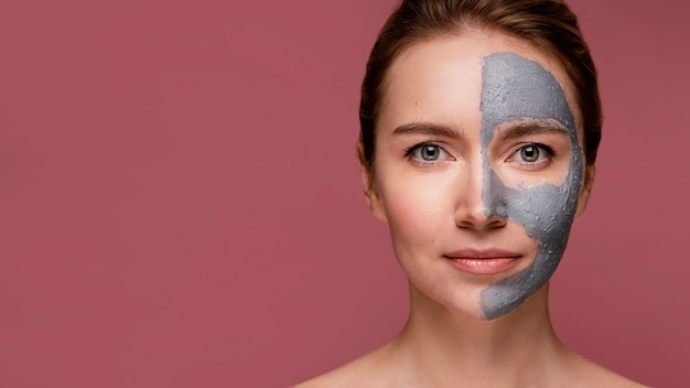 Beautiful woman having half of her face covering with mask