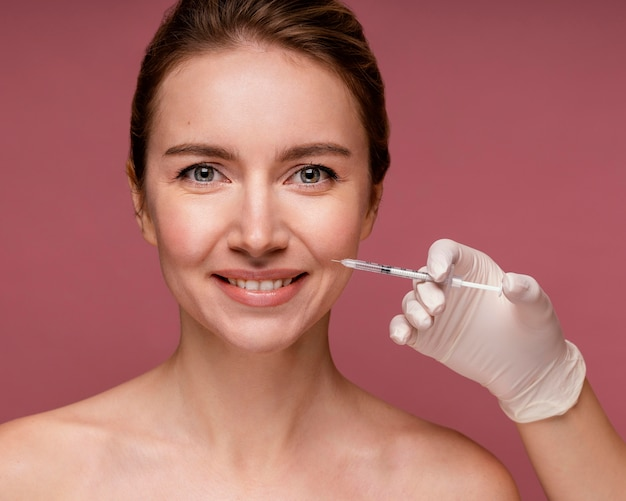 Beautiful woman having her face injected