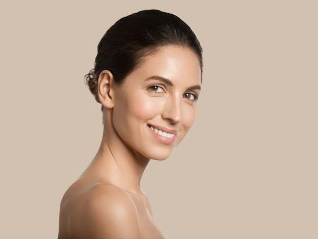 Beautiful woman healthy skin beauty face cosmetic concept color background. brown.