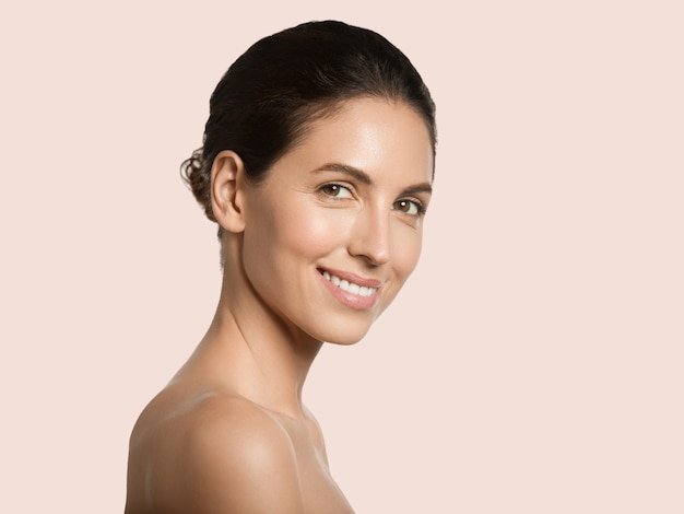 Beautiful woman healthy skin beauty face cosmetic concept color background. pink.