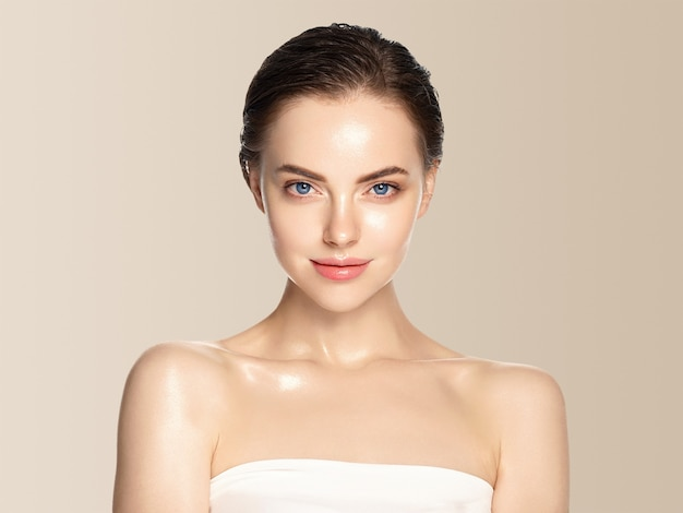 Beautiful woman healthy skin care concept portrait close up beige background. studio shot