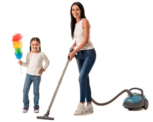 Beautiful woman and her daughter are looking at camera. cleaning concept