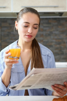 Beautiful woman hold in arms glass of orange juice