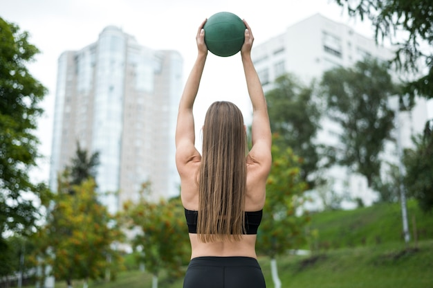 Beautiful woman holding a ball  medium shot