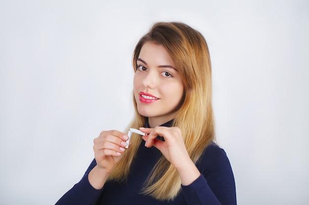 Beautiful woman holding broken cigarettes