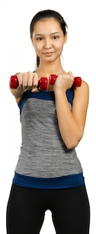 Beautiful woman holding dumbbells isolated on white