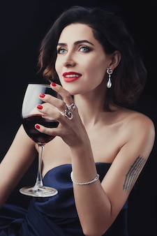 Beautiful woman holding a glass wine