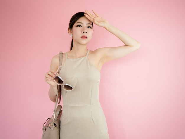 Beautiful woman holding glasses and carrying leather bags,fashion concept