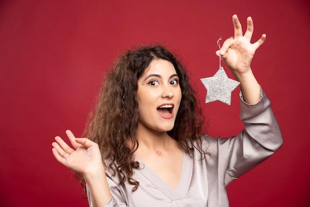 Beautiful woman holding glittery star.