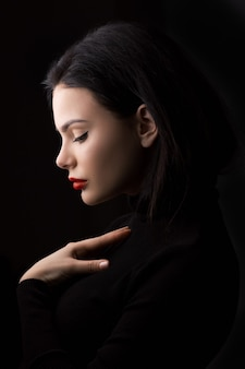 Beautiful woman holding herself chest and heart two hands