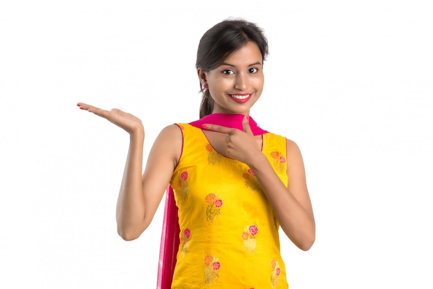 Beautiful woman holding and presenting something on the hand with happy smiling.