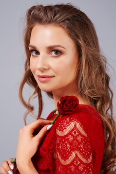 Beautiful woman holding a red rose