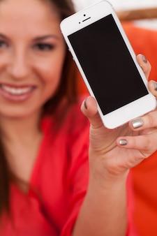 Beautiful woman holding smartphone