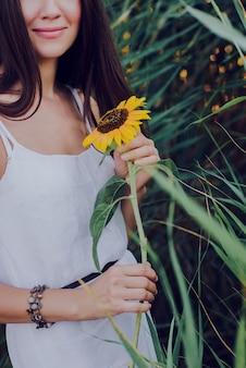 Beautiful woman holding sunflower