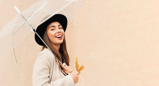 Beautiful woman holding an umbrella with copy space