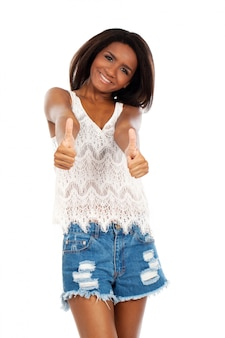 Beautiful woman holds her thumbs up