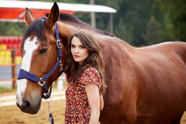Beautiful woman and horse outdoors.