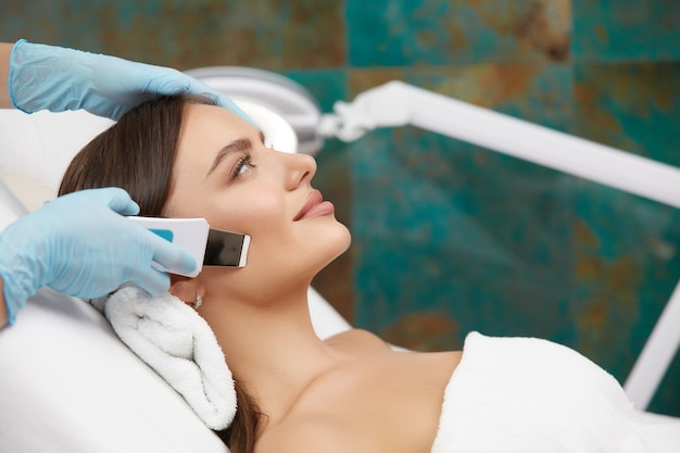 The beautiful woman is in the cosmetic salon, front view