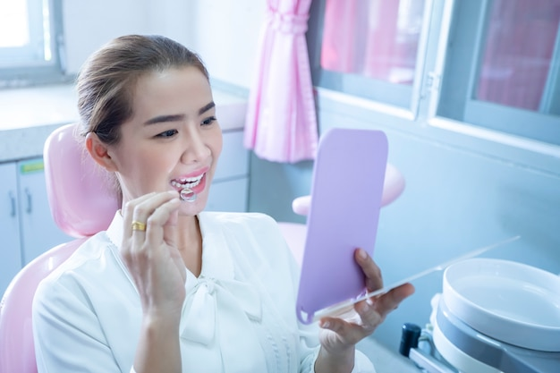 A beautiful woman is doing a dental checkup by herself. for healthy mouth and teeth