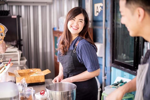 Beautiful woman is making bakery