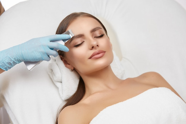 The beautiful woman is in spa salon