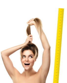 Beautiful woman is very happy of her hair growth progress. isolated.