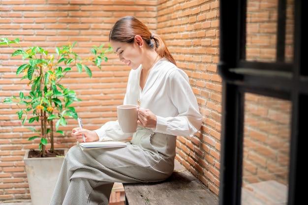 Beautiful woman is working in backyard