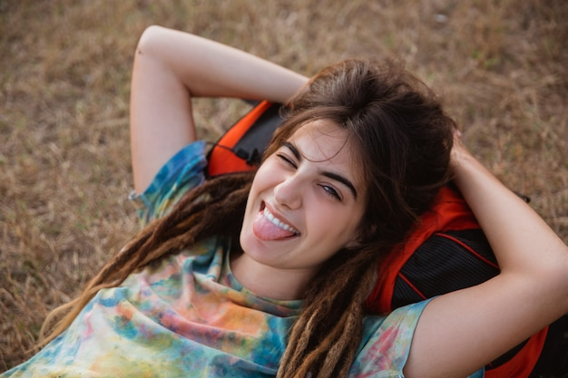 Beautiful woman lay on grass looking camera enjoy the traveling